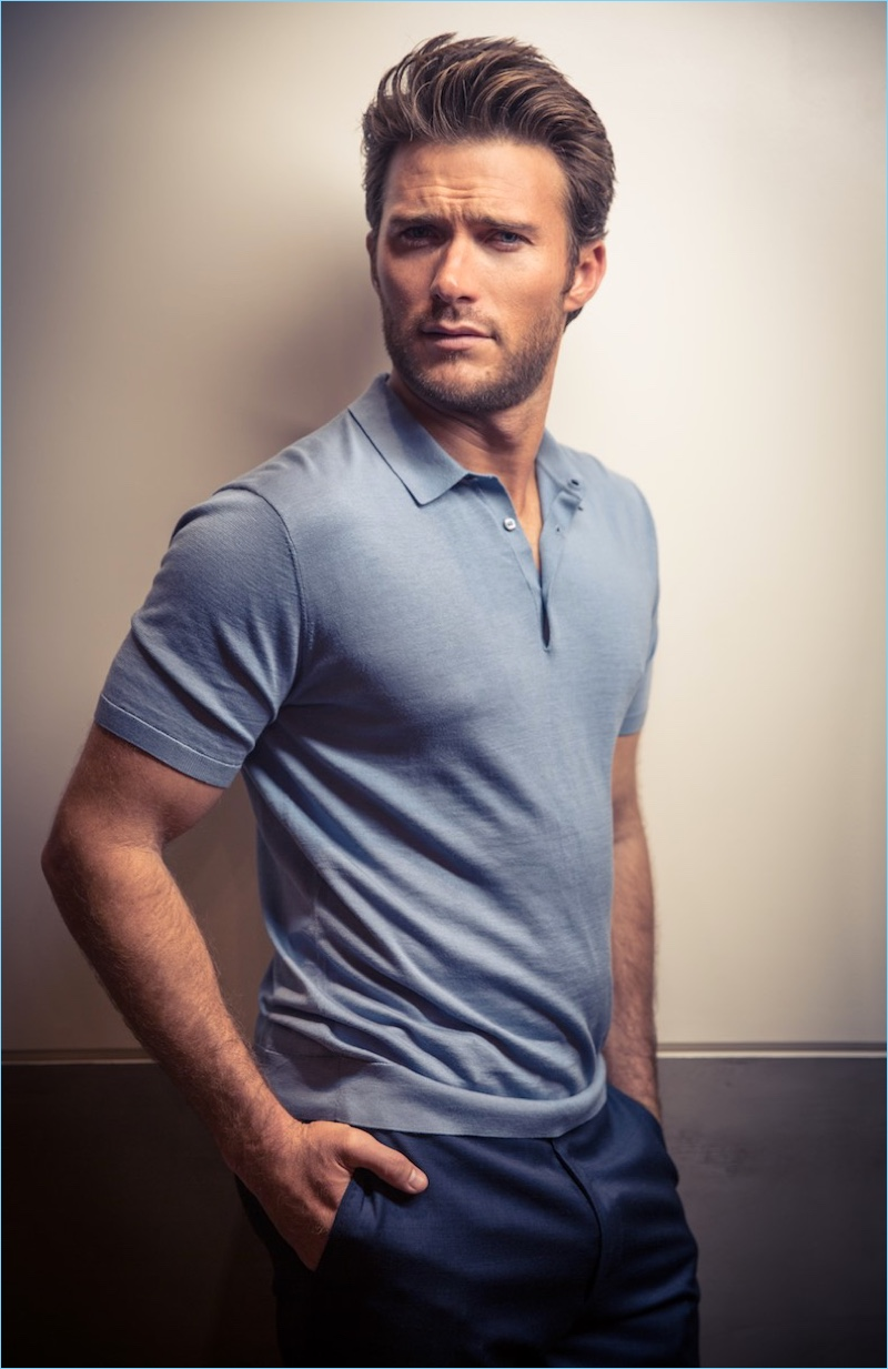 Starring in a new photo shoot, Scott Eastwood wears a COS polo and Giorgio Armani trousers.