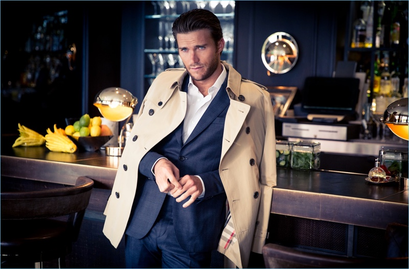 A striking vision, Scott Eastwood wears a Salvatore Ferragamo suit with a Burberry trench.