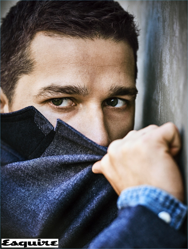 Starring in a new photo shoot, Shia LaBeouf wears a RRL jacket with a POLO Ralph Lauren shirt.
