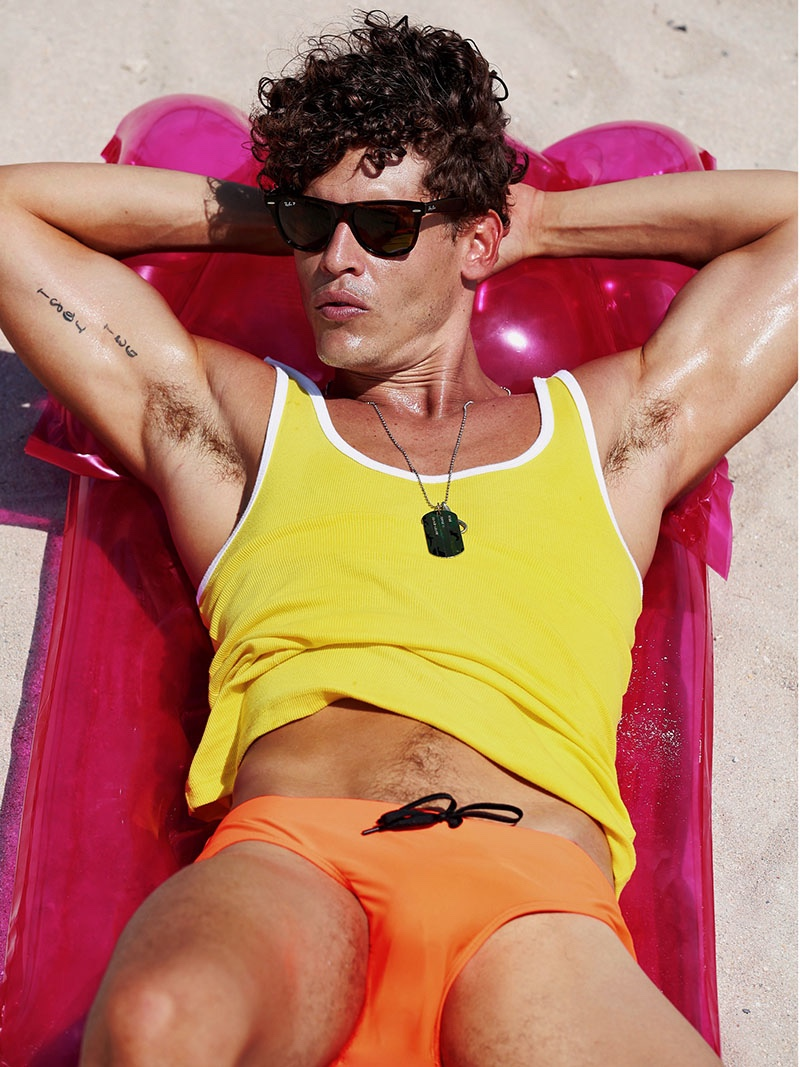 Sidney wears tank 2(X)ist, sunglasses Ray-Ban, and swimsuit Vilebrequin.