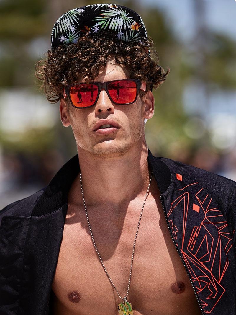 Sidney wears jacket Marcelo Burlon, sunglasses Givenchy, and necklace John Hardy.