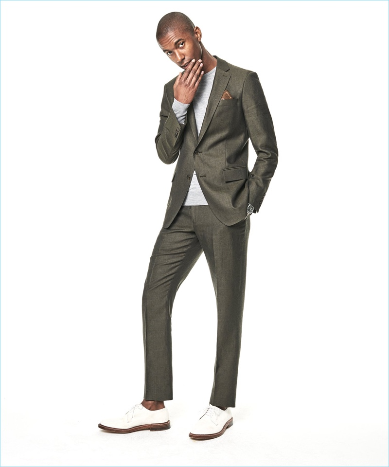 Claudio Monteiro dons Todd Snyder's Sutton linen suit in olive.