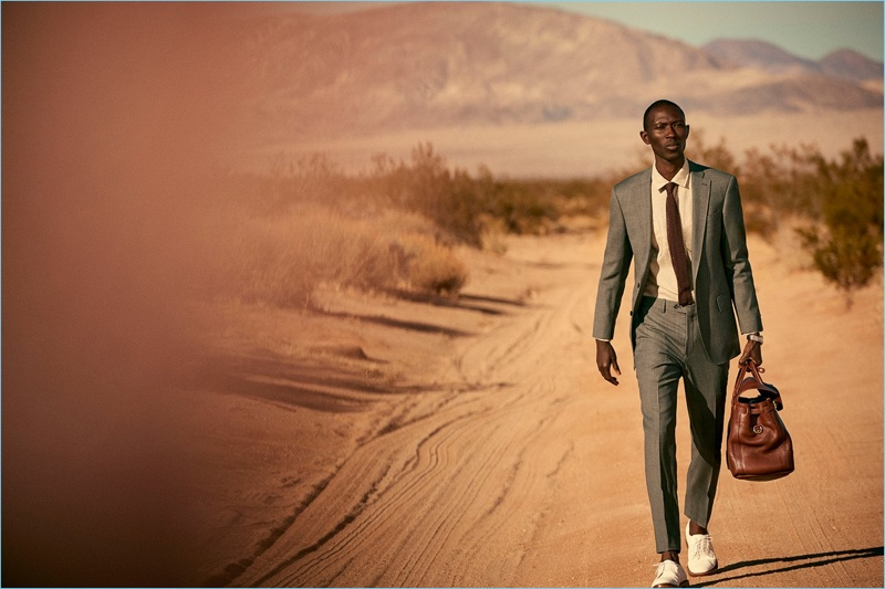 Taking to the desert, Armando Cabral dons a Todd Snyder White Label Sutton stretch tropical wool suit in light charcoal.