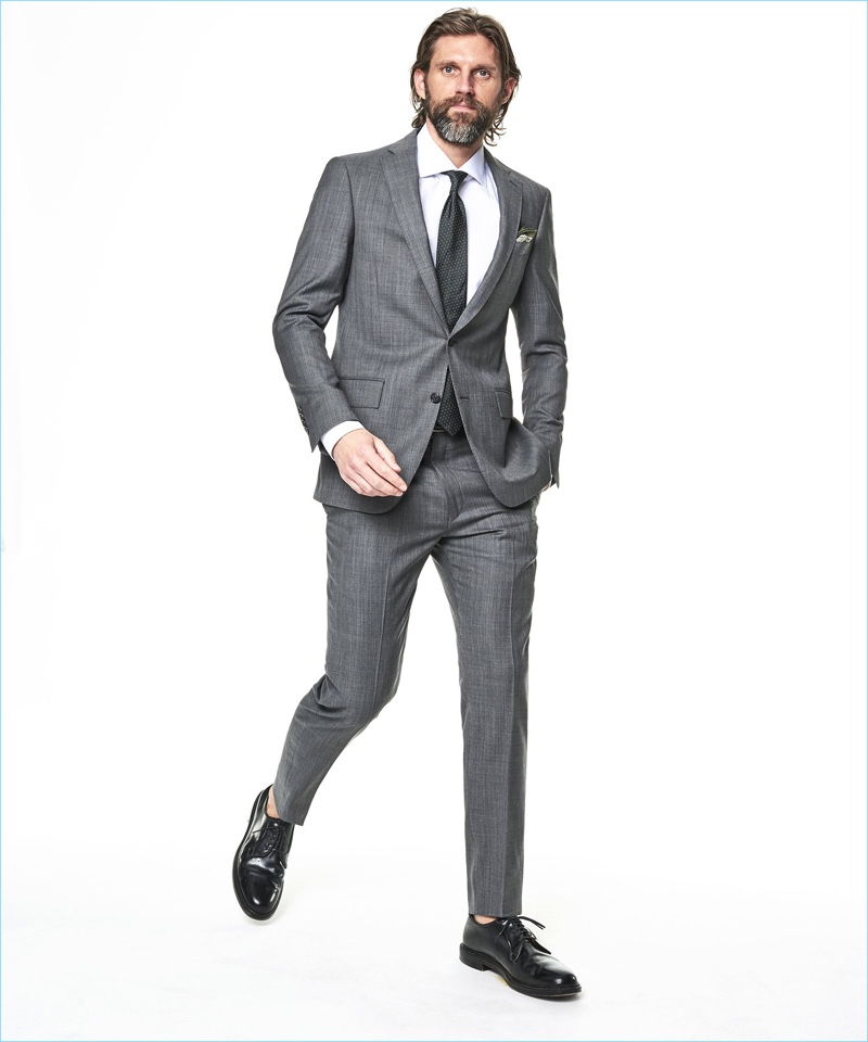 RJ Rogenski models a Todd Snyder White Label Sutton stretch tropical wool suit in light charcoal.