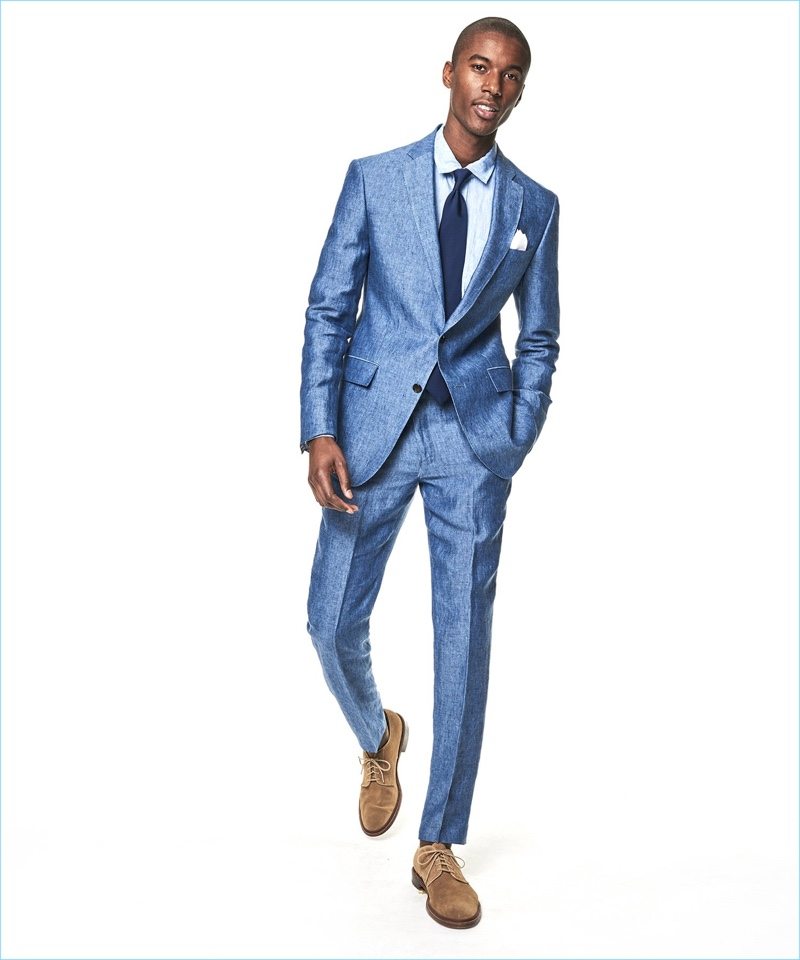 Model Claudio Monteiro wears a Todd Snyder White Label Sutton linen suit in ice blue.
