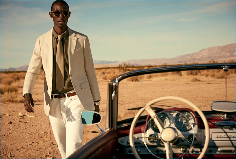 Embracing neutrals, Armando Cabral wears a Todd Snyder White Label unconstructed linen sport coat in beige.