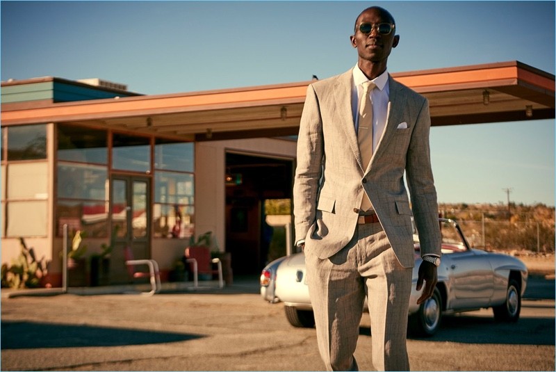 Looking sharp, Armando Cabral wears a Todd Snyder White Label Sutton windowpane linen suit in grey.