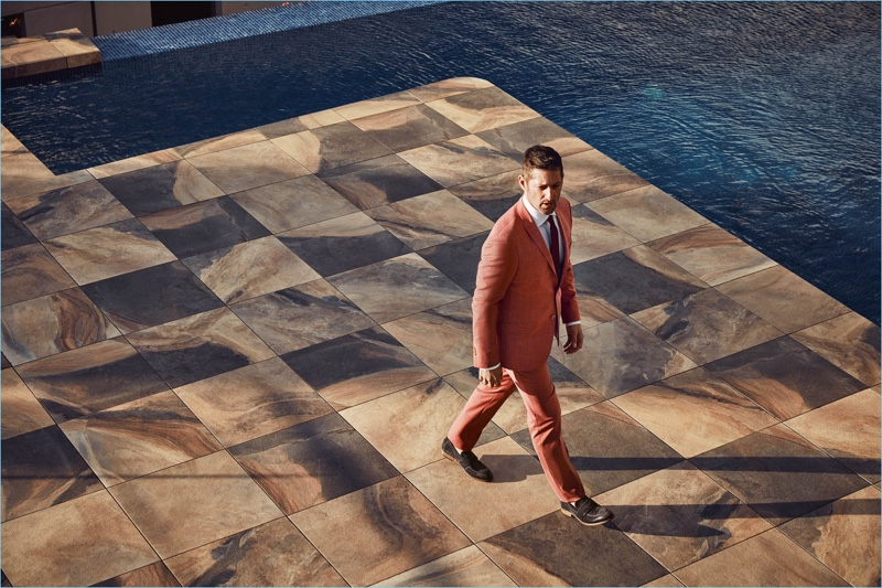 Donning a sleek coral suit, Tony Ward fronts Wormland's spring-summer 2018 campaign.