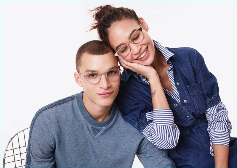 Embracing a round frame, Louis Mayhew models Warby Parker's Newland eyeglasses in polished silver.