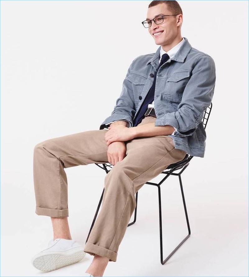 All smiles, Louis Mayhew wears Warby Parker's Hawthorne eyeglasses in black.