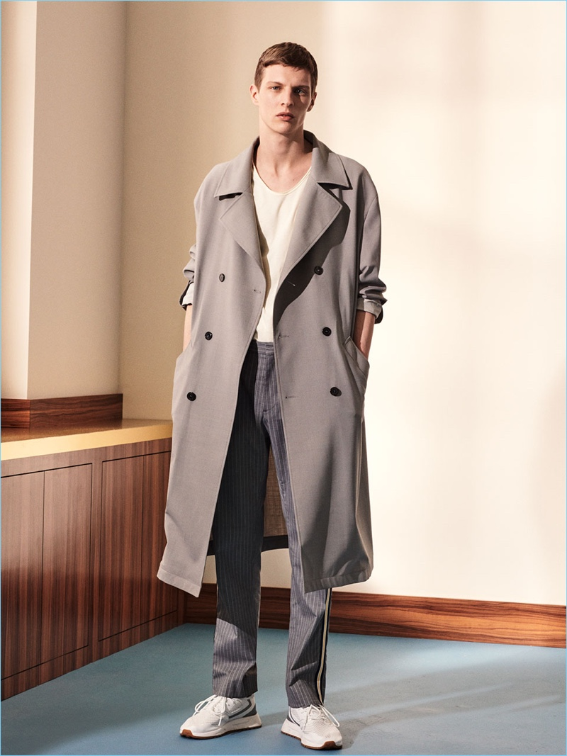 Tim Schuhmacher dons a trench and pinstripe pants by Zara Man. 1035966a0d4