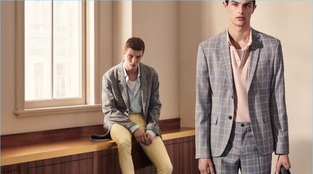 Models Tim Schuhmacher and Hannes Gobeyn don sleek suits by Zara Man.