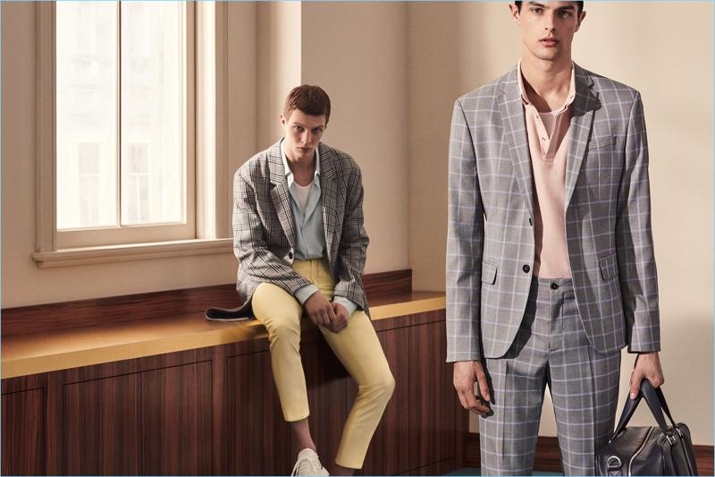 Models Tim Schuhmacher and Hannes Gobeyn don sleek suits by Zara Man. 54908c56847