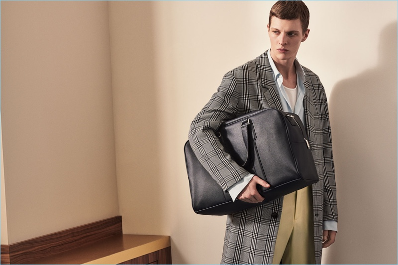 Making a case for checks, Tim Schuhmacher wears a sleek Zara Man coat.