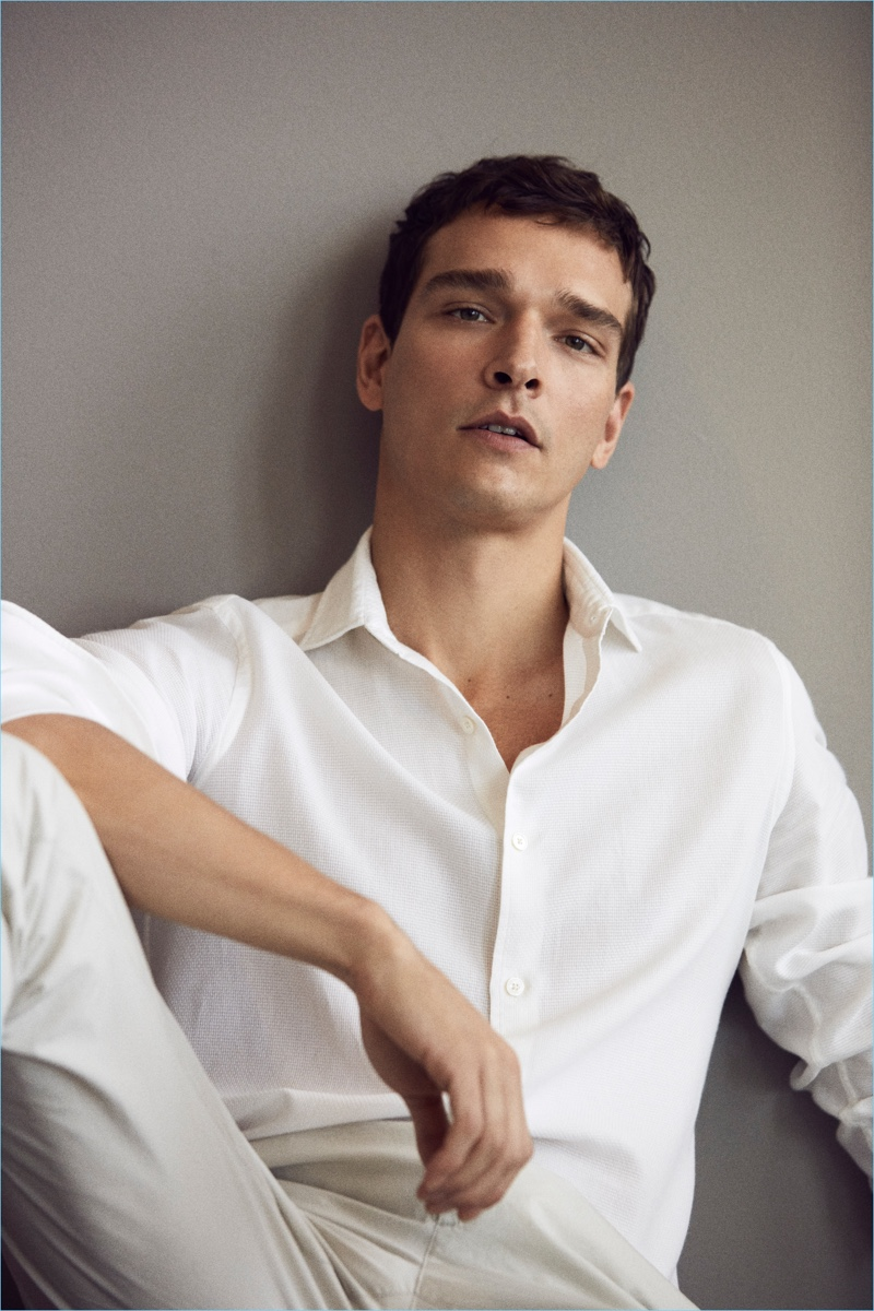 Brazilian model Alexandre Cunha dons a chic white look by Massimo Dutti.