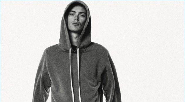 Front and center, Simon Kotyk wears a hoodie and sweats by BILLY.