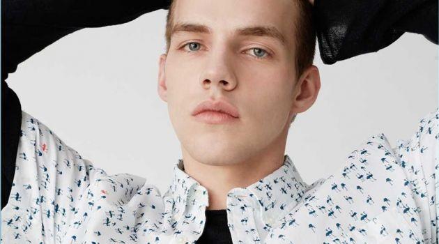 Benji Staker wears a short-sleeve flamingo print shirt from Club Monaco.