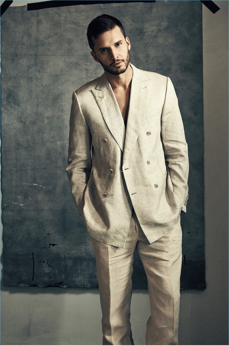 Donning a double-breasted suit, Dejan Obradović is styled by Paul Frederick.