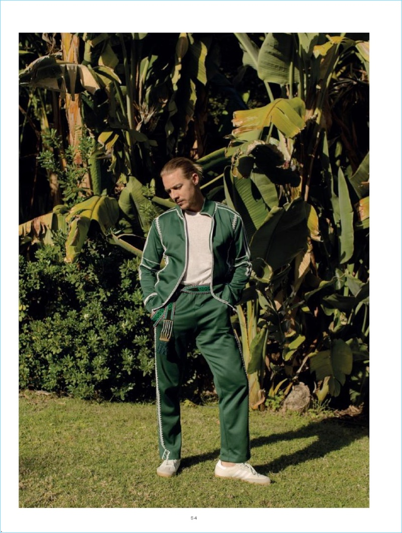 Going sporty, Diplo wears a Valentino tracksuit with a Billy Los Angeles t-shirt and Adidas sneakers.