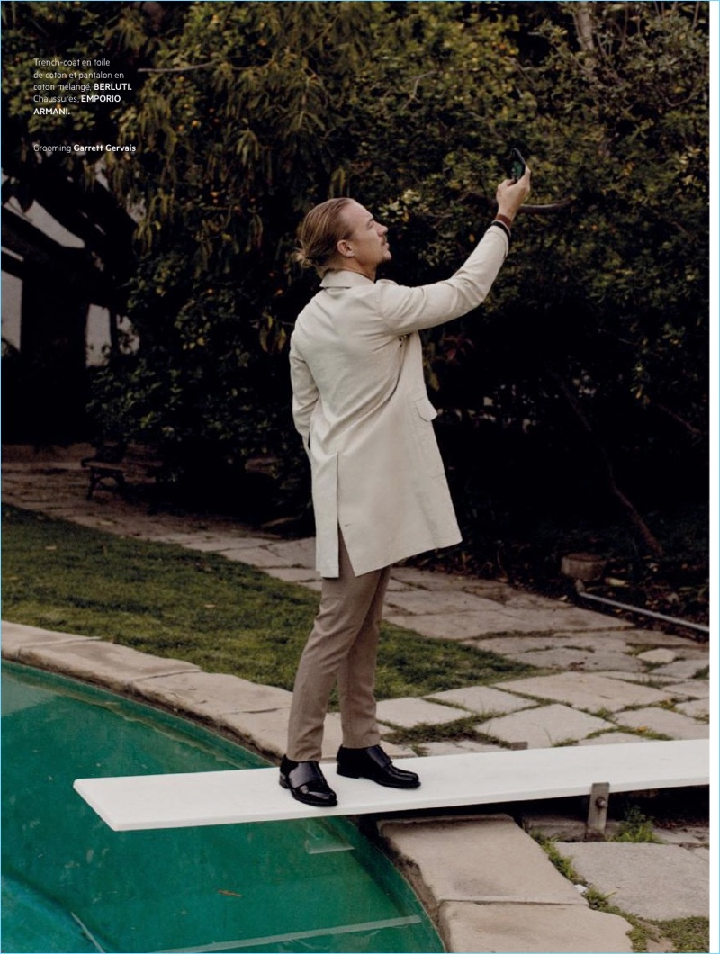 Appearing in a photo shoot, Diplo wears a Berluti trench and pants with Emporio Armani shoes.