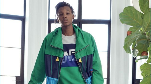 Going sporty, Matthew Davidson wears a parka, shorts, sweatshirt, and sneakers from Kenzo.
