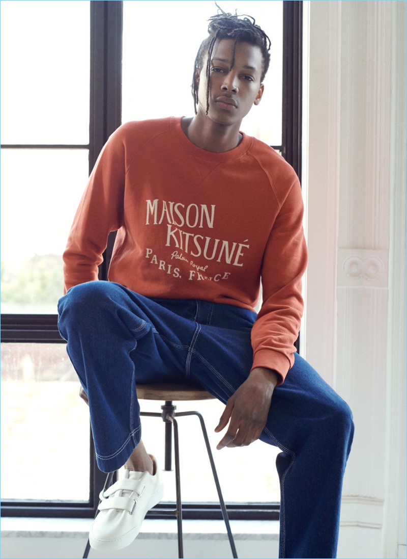 Sporting key essentials, Matthew Davidson sports a Maison Kitsune sweatshirt, AMI jeans, and Soloviere sneakers.
