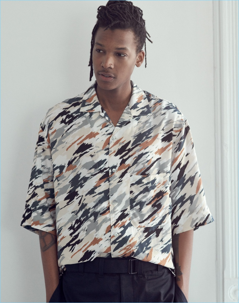 Model Matthew Davidson wears a Lemaire printed shirt and belted pants with Zespa sneakers.