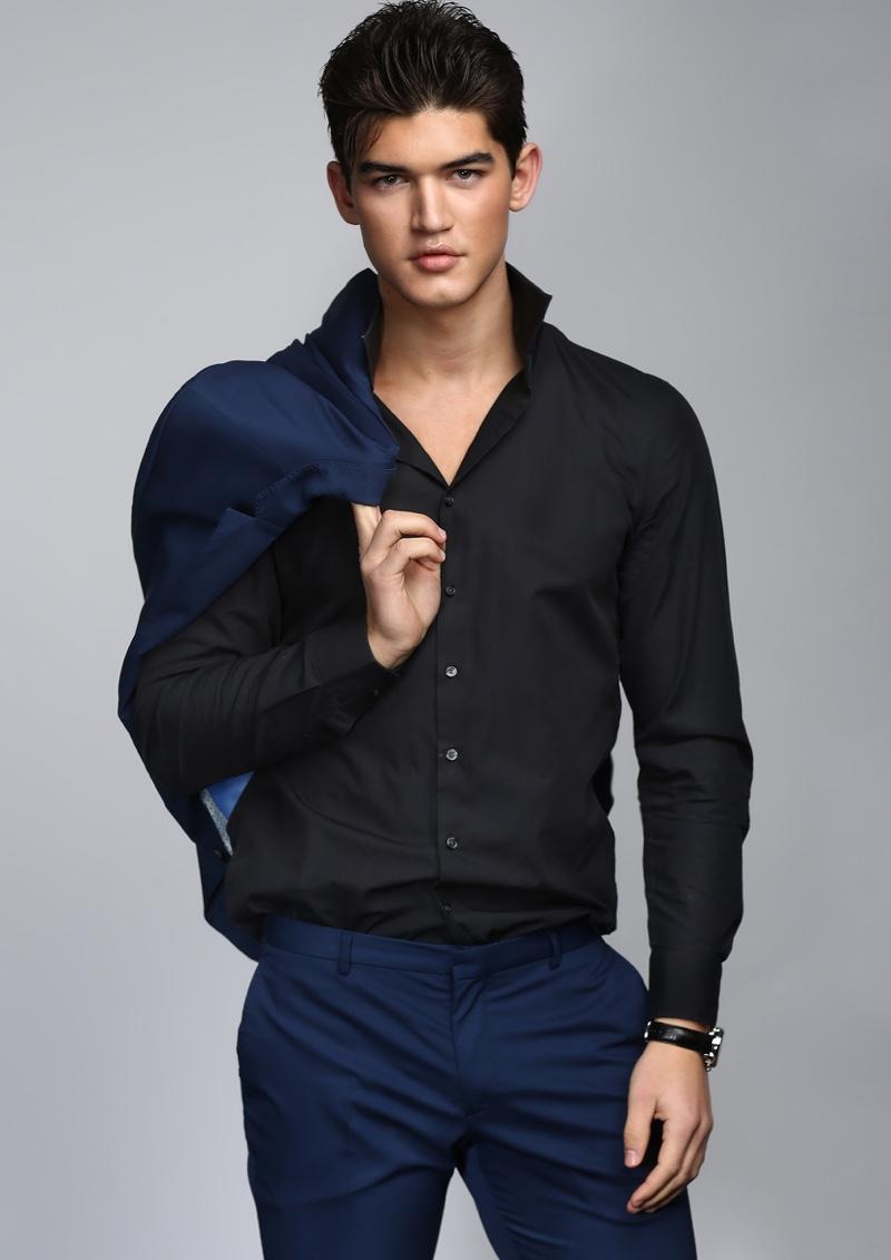 Linus wears shirt Jake's, watch Tissot, and suit Zara Man.