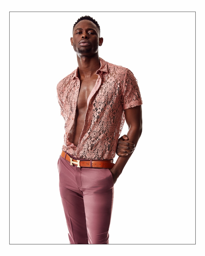 Mac Phiri wears a lace Topman shirt and trousers with an Hermès belt.