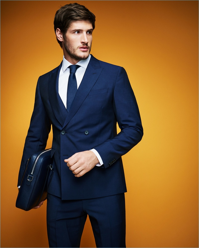 A sleek vision, Ryan Tift dons a navy BOSS wool/mohair suit.