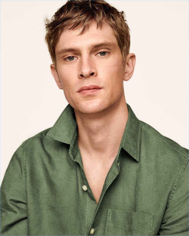 Danish model Mathias Lauridsen wears a Gap standard fit half-button shirt in linen-cotton.