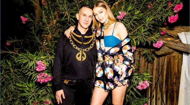 Jeremy Scott and Gigi Hadid wear looks from the H&M x Moschino collaboration collection.