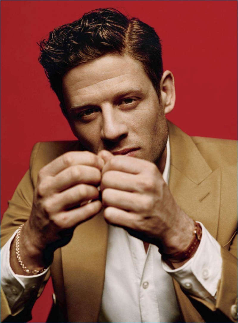 Starring in a stylish photo shoot, James Norton wears a BOSS shirt and jacket. He accessorizes with a Cartier watch and bracelet by The Great Frog.
