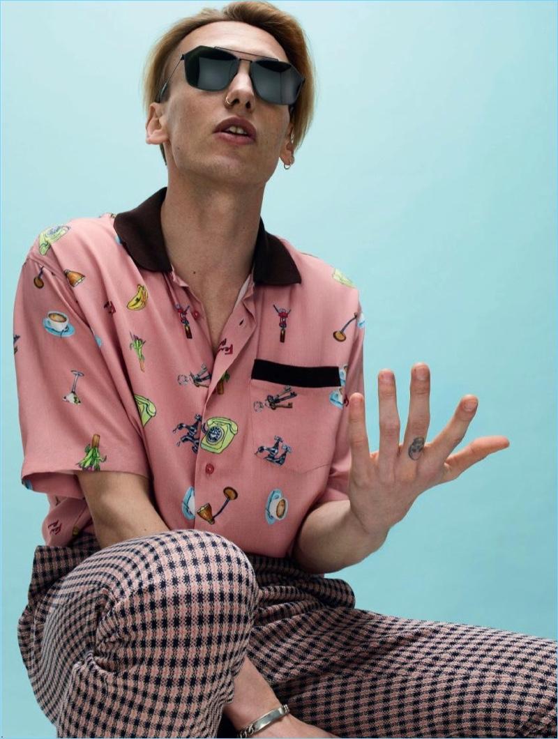 Channeling a retro attitude, Jamie Campbell Bower wears Fendi.