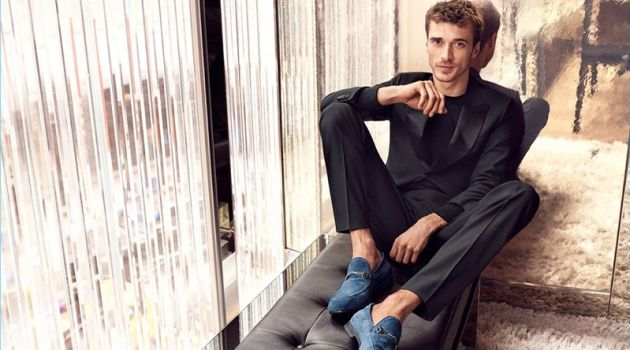 French model Clément Chabernaud wears suede loafers for Jimmy Choo's pre-fall 2018 campaign.