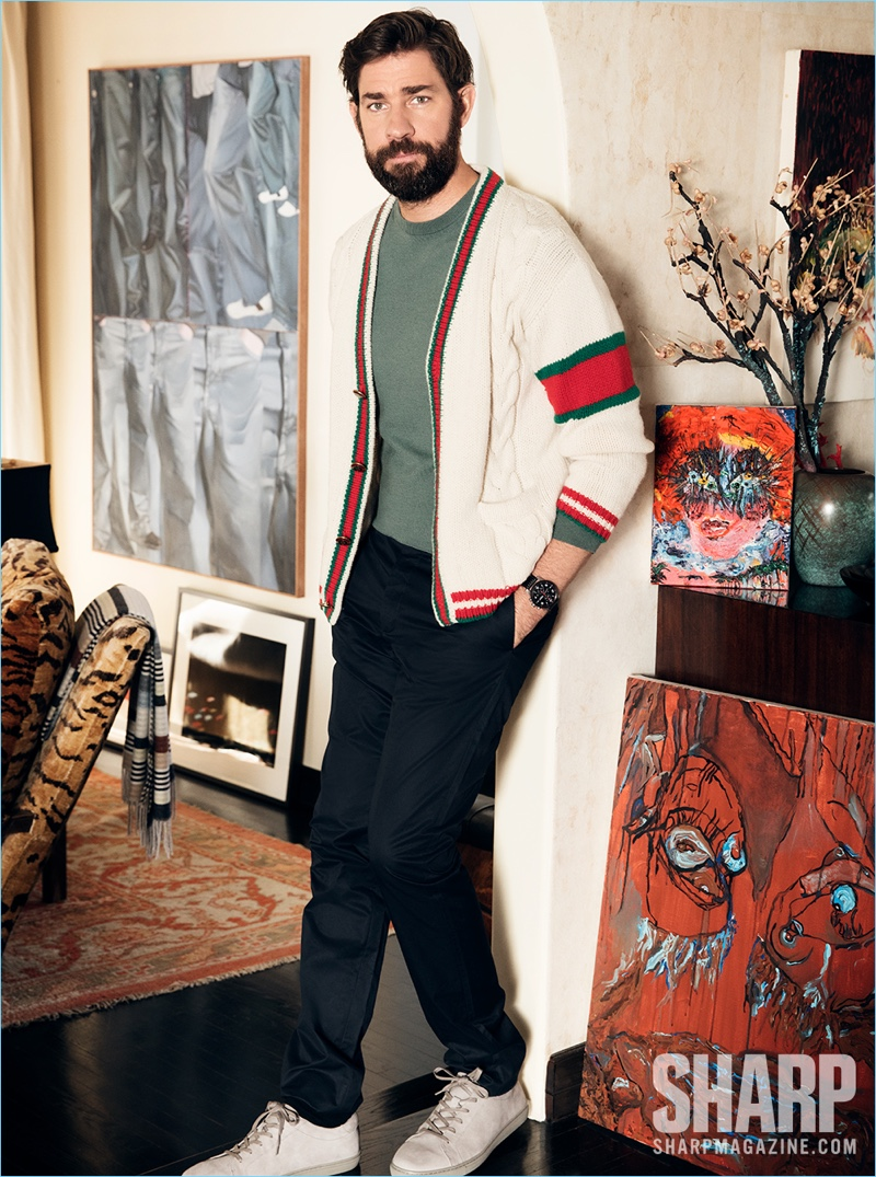 Actor John Krasinski wears a Gucci cardigan with a Louis Vuitton sweater and pants. He also sports Kenneth Cole sneakers and a Montblanc watch.