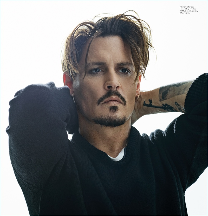 Wearing Dior Homme, Johnny Depp is front and center.