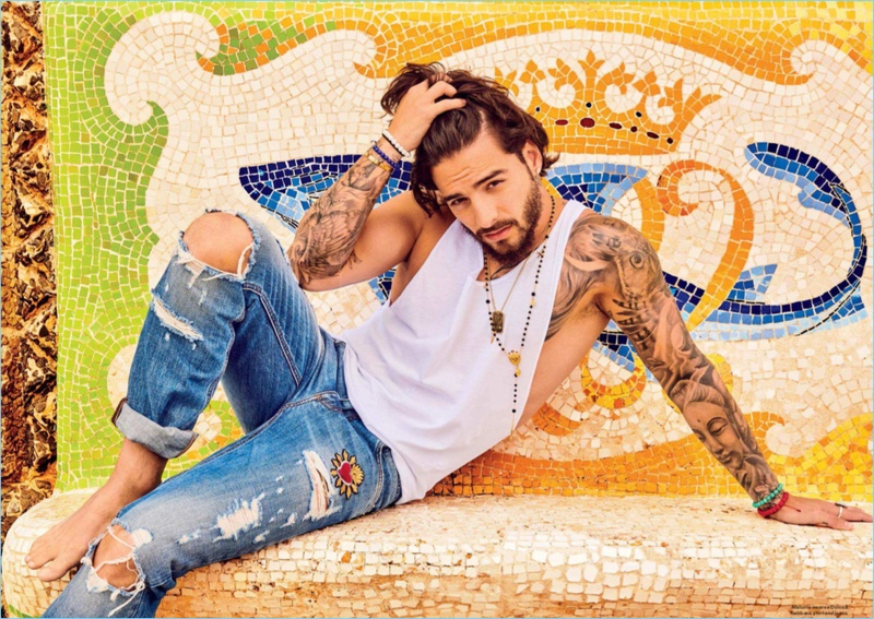 Rocking distressed denim, Maluma wears Dolce & Gabbana.
