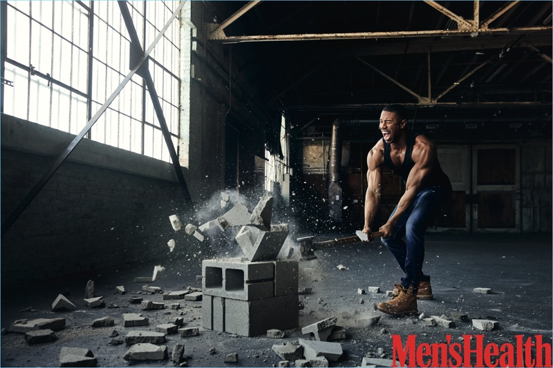 Starring in a Men's Health photo shoot, Michael B. Jordan wears a Calvin Klein tank with AG jeans and Timberland boots.