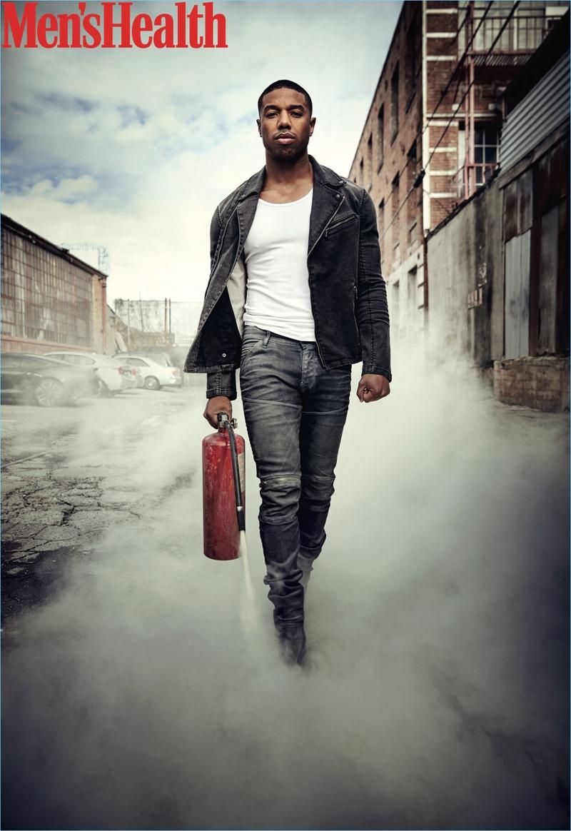A cool vision, Michael B. Jordan wears a John Varvatos Star USA jacket, Mack Weldon tank, G-Star jeans, and To Boot New York boots.