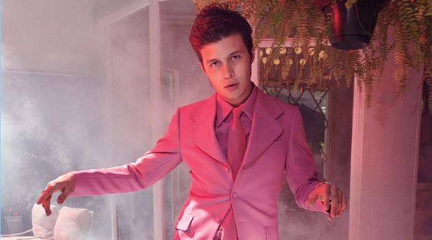 Showcasing his best dance moves, Nick Robinson wears a pink Gucci suit, shirt, and tie.