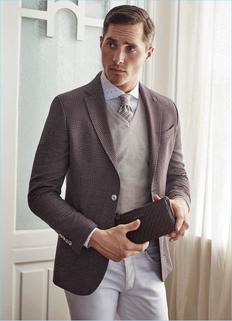 A dapper vision, Ollie Edwards fronts Damat's spring-summer 2018 outing.