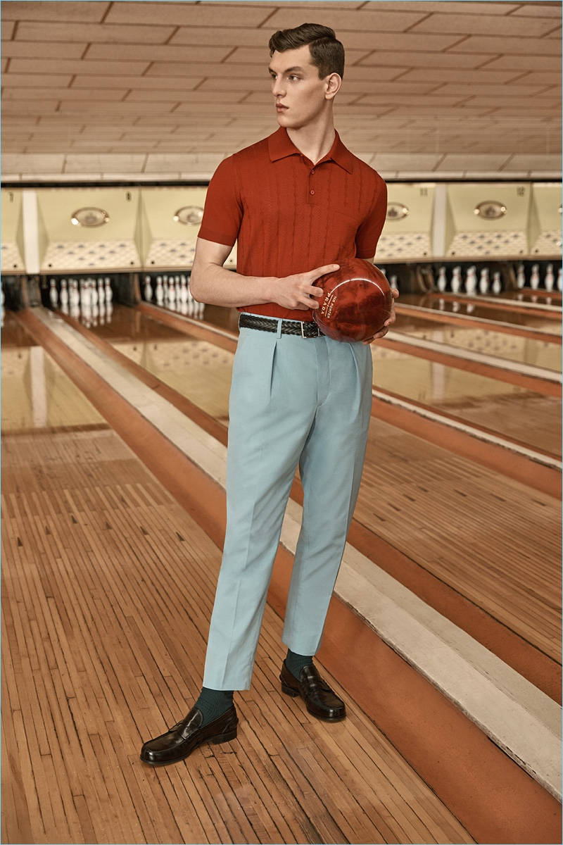 A smart vision, Luke Farley dons Prada's virgin wool polo with tapered trousers.