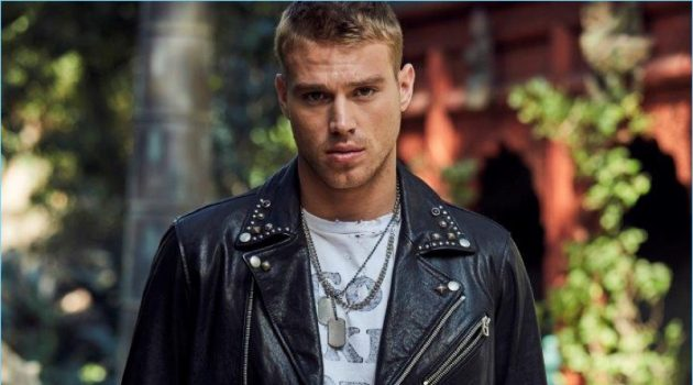 Channeling his inner bad boy, Matthew Noszka rocks a leather biker jacket and denim from Replay Jeans.