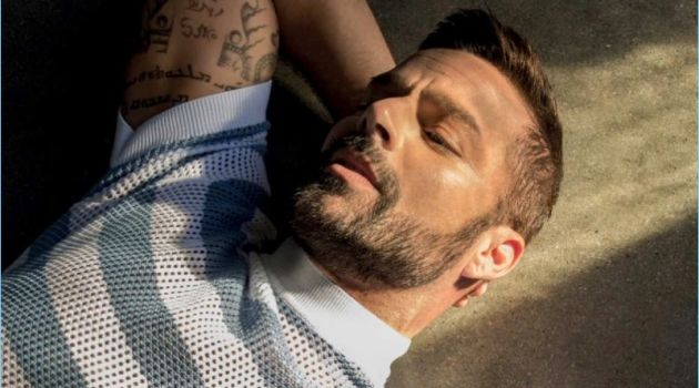 Starring in a photo shoot, Ricky Martin wears a striped mesh top by Prada.