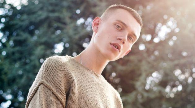 Ruben wears sweater Zara and pants Adidas Originals.