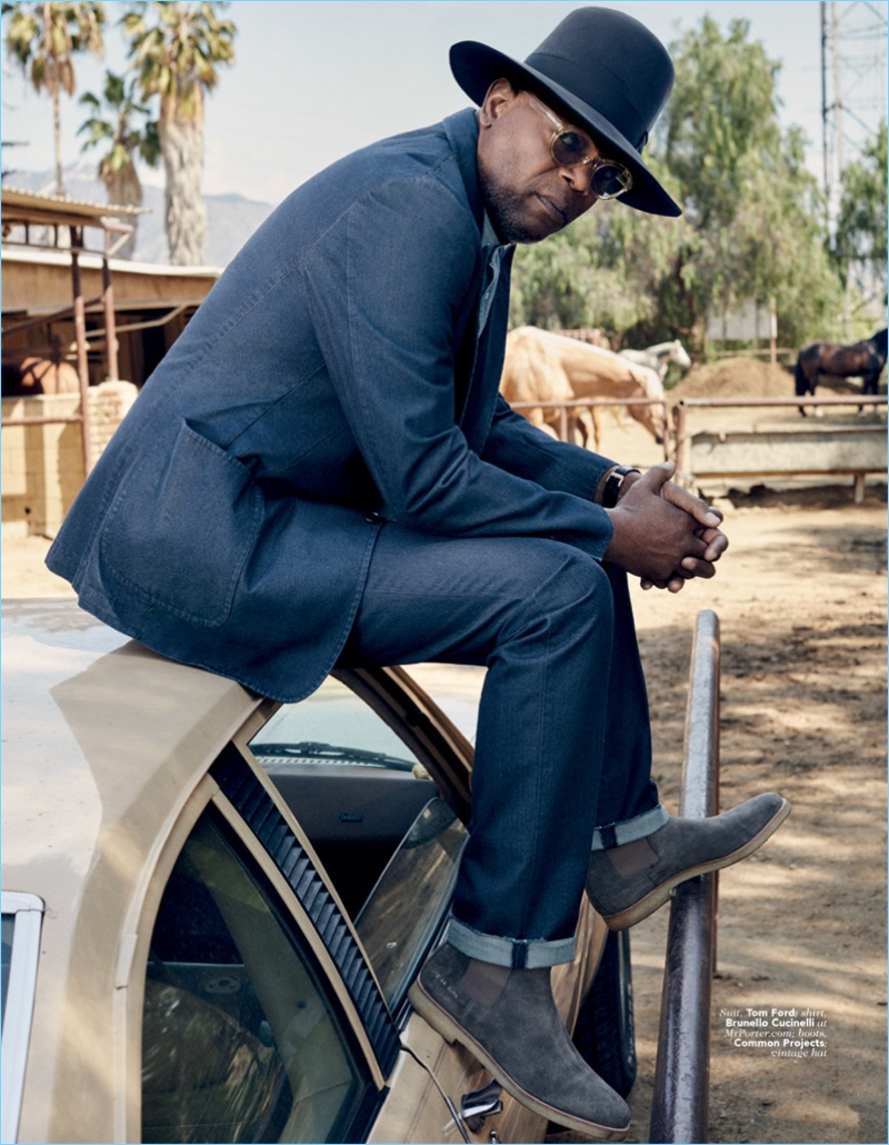 A cool vision, Samuel L. Jackson wears a Tom Ford suit with a Brunello Cucinelli shirt. He also rocks Common Projects boots and a vintage hat.