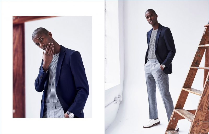Linen & Stripes: A sleek vision, Claudio Monteiro wears a Todd Snyder suit jacket in navy with grey linen trousers. Tapping into a smart casual aesthetic, he also sports a Todd Snyder pocket tee.