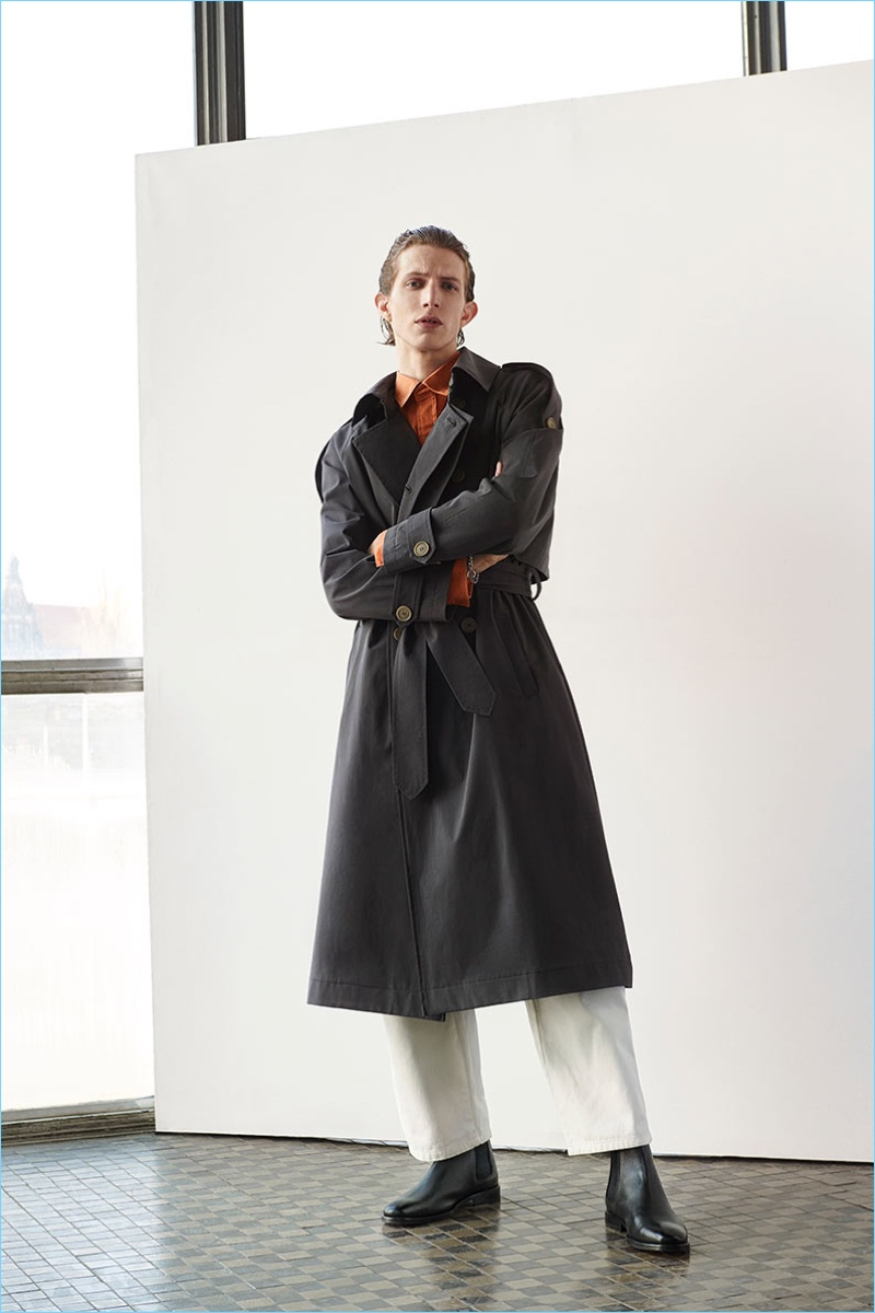 Xavier Buestel dons a trench from Reserved's Re.Design.02 collection.