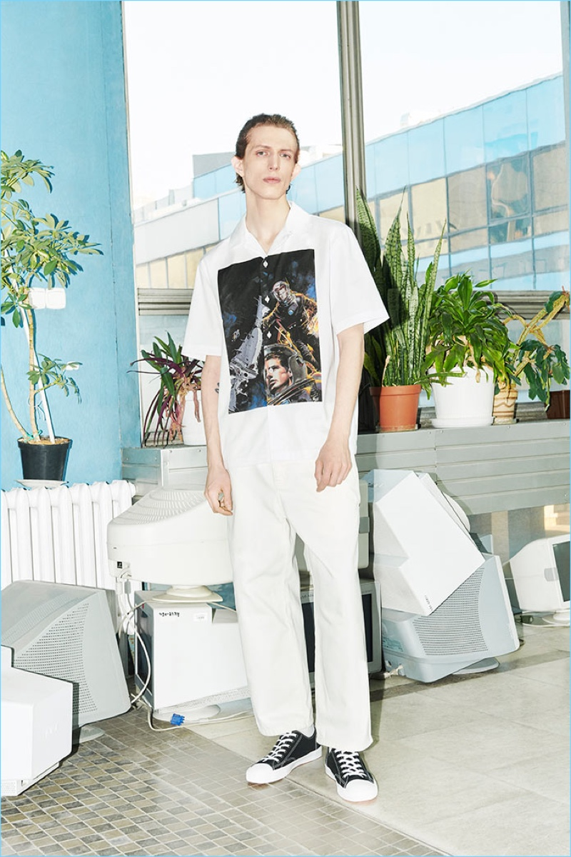 Embracing an all-white look, Xavier Buestel wears pieces from Reserved's Re.Design.02 collection.